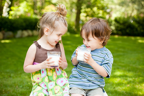 Boy and girl drinking milk