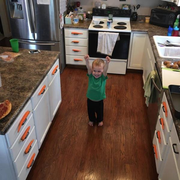 Samson Olive little boy hiding carrots