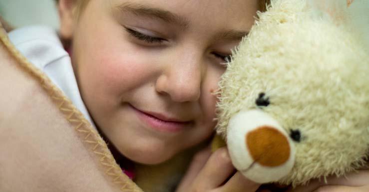 Girl sleeping with teddy