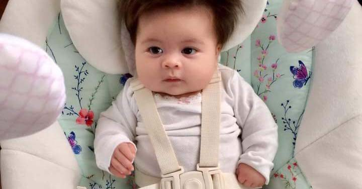 this 2-month-old baby already has better hair than most of us