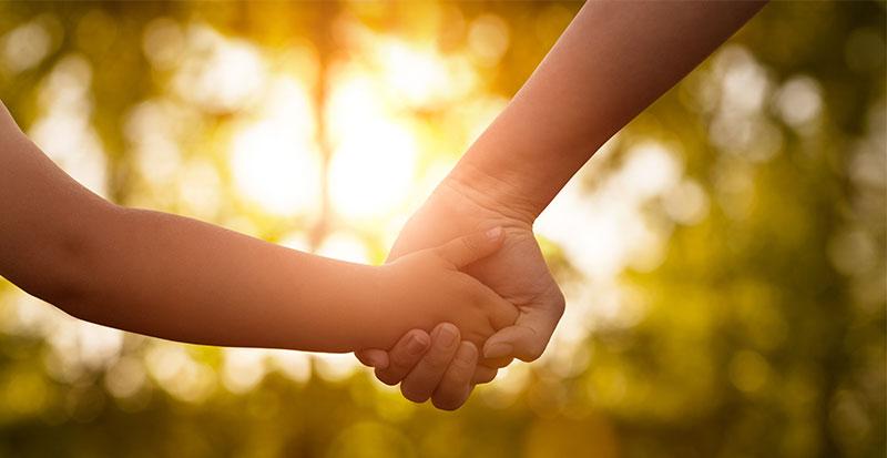 mum and child holding hands
