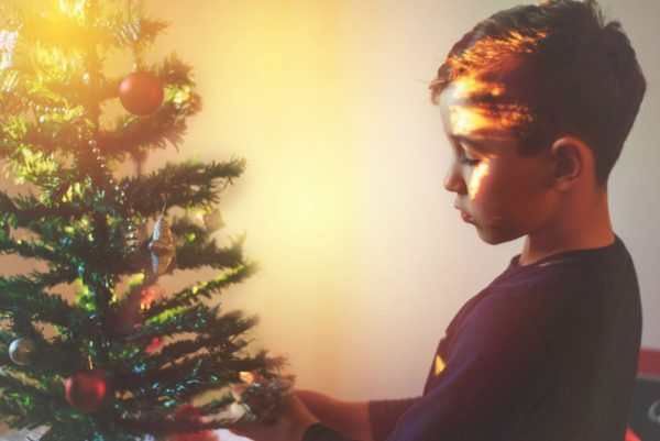 Boy decorating the Christmas tree