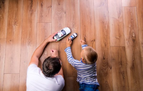 Father playing cars with son