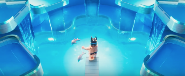 Lego Batman at his pool with some dolphins