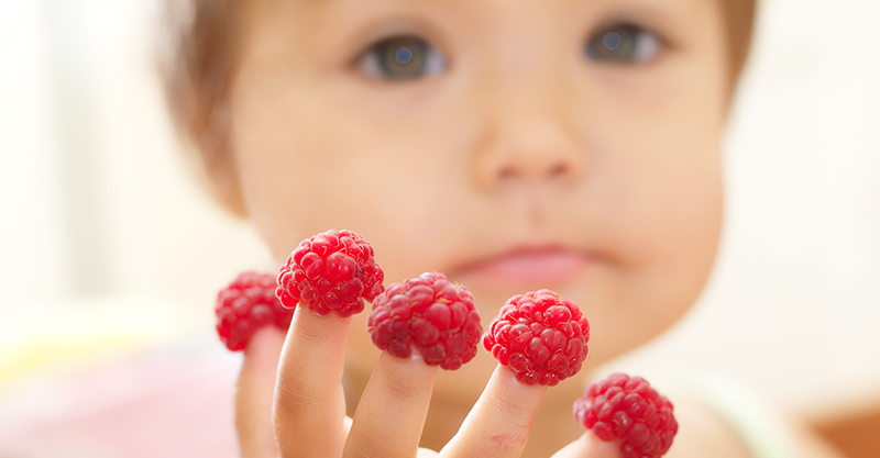 baby with raspberry fingers