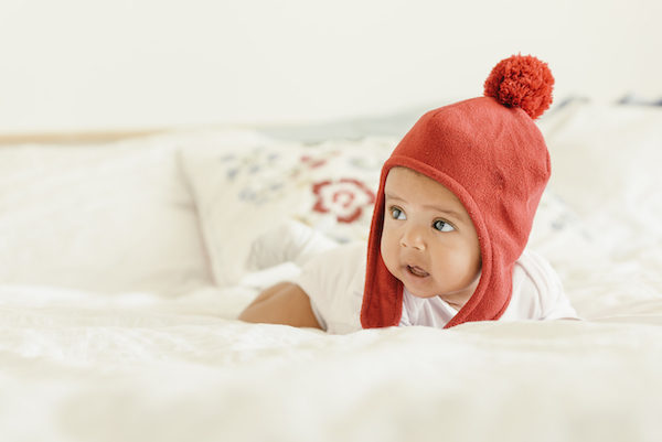 baby girl wearing red hat