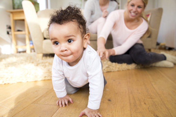 Baby boy crawling at home