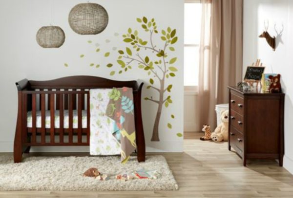 nursery with dark wooden cot