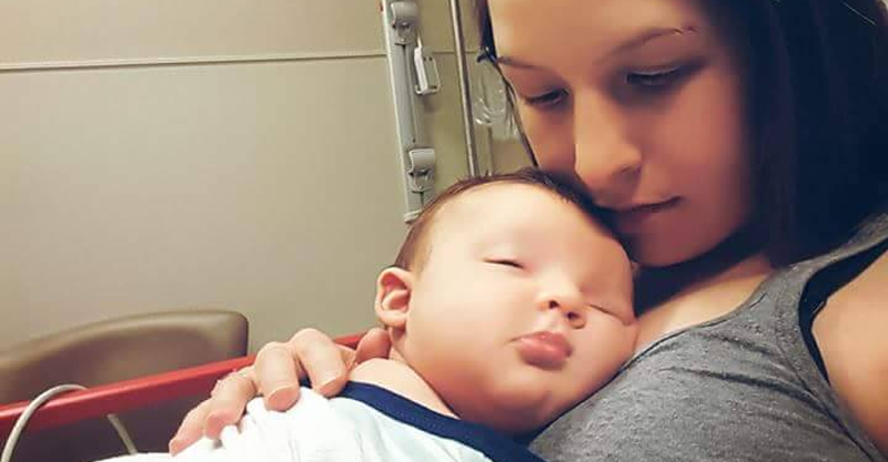 Mum holding baby boy after choking