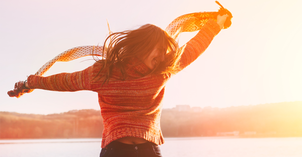 happy woman jumping with scarf