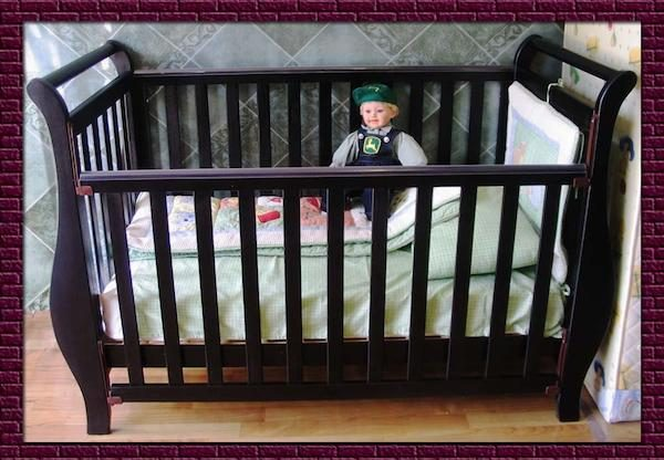 Recalled sleigh-type cot