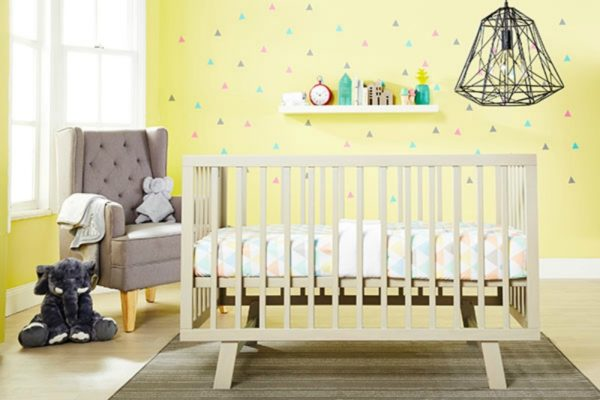 nursery with cot and yellow walls