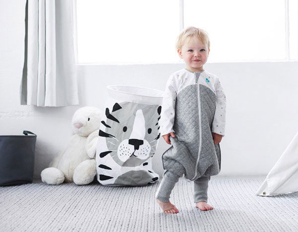 toddler wearing love to dream sleepsuit
