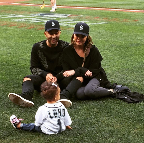 Chrissy teigen and John Legend at baseball with Luna
