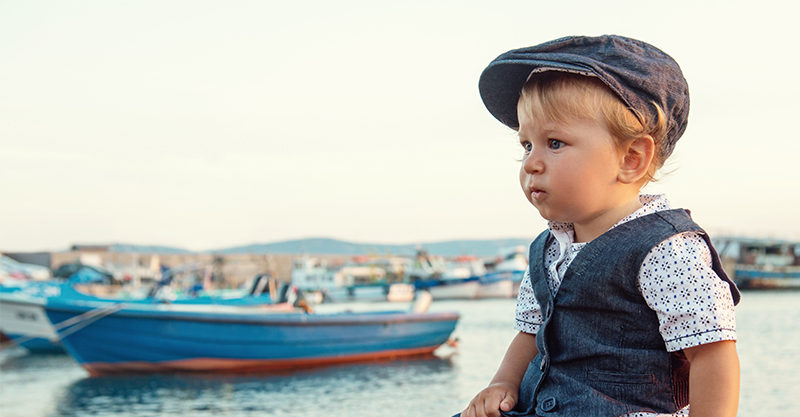 Little boy and boat