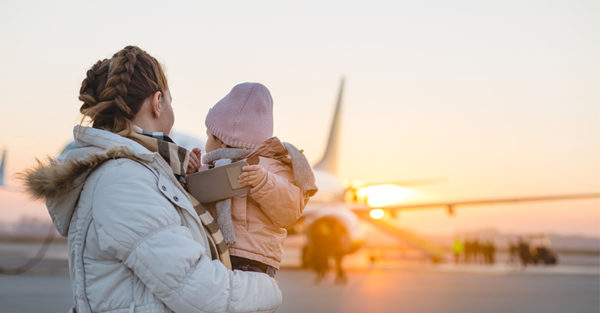 Woman with child near plane