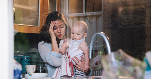 stressed mum and baby in kitchen