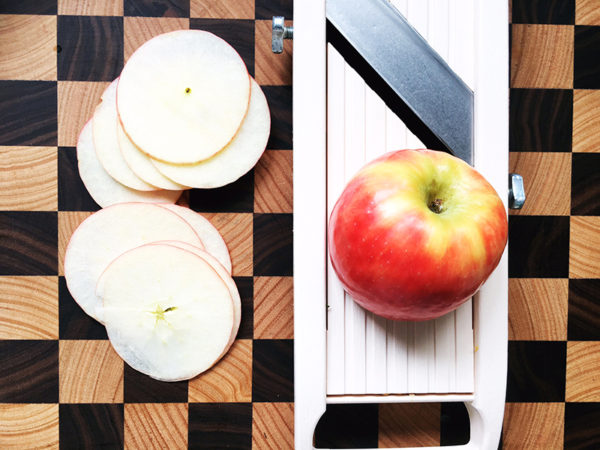 slicing apples with a mandolin