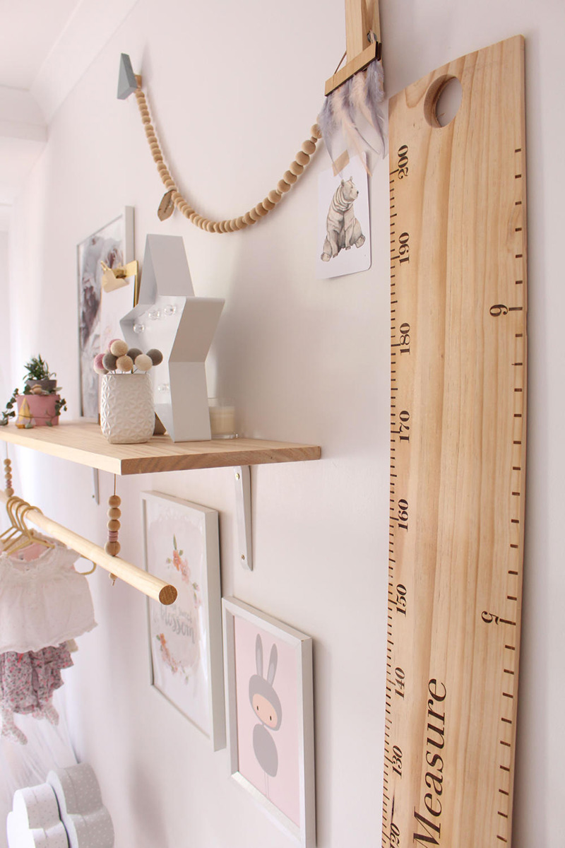 wooden ruler height chart in bedroom