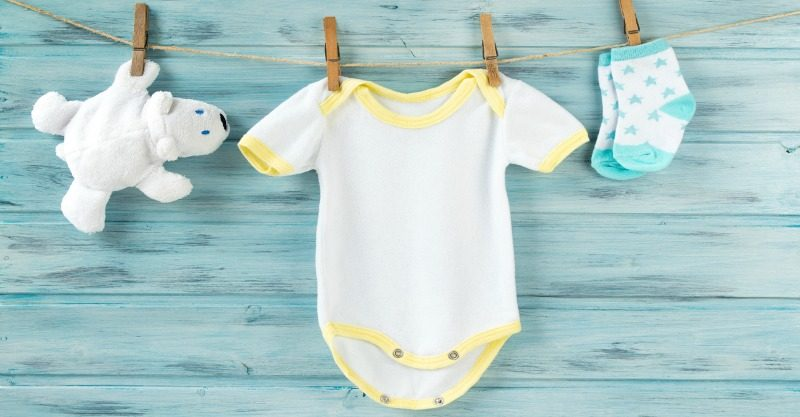 baby clothes and bear on clothesline