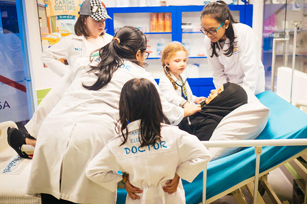 Children role playing being doctors at Kidzania
