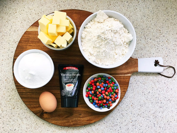 ingredients for funfetti biscuits cookies on a wooden board