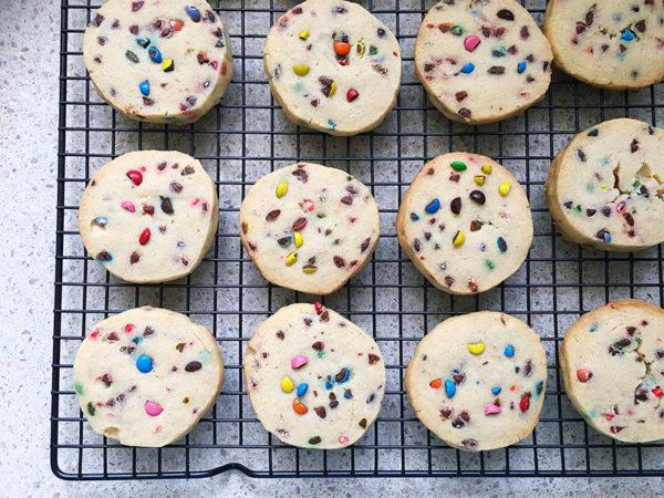 vanilla funfetti cookies on a baking tray