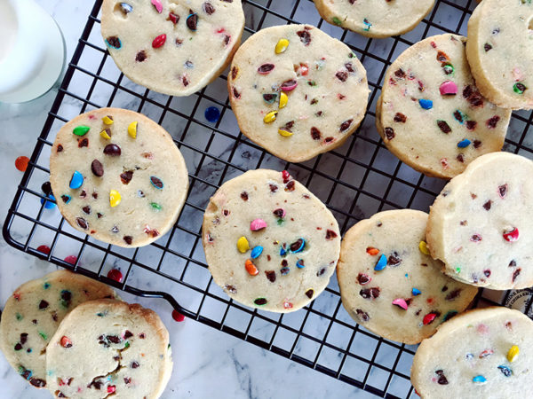 baked vanilla funfetti biscuits on a baking tray