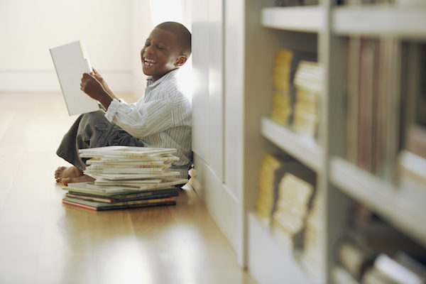 Boy reading and laughing