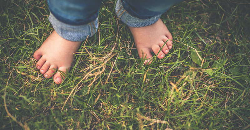 boy feet in grass