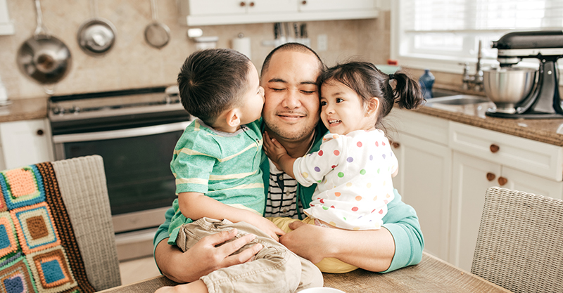 kids hugging dad