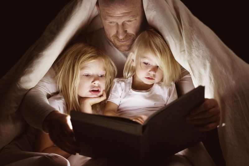Dad reading to girls in test