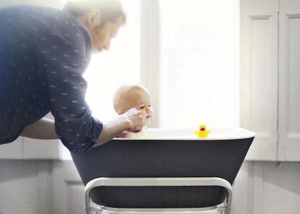 Man bathing baby