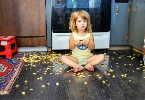 child eating food on floor