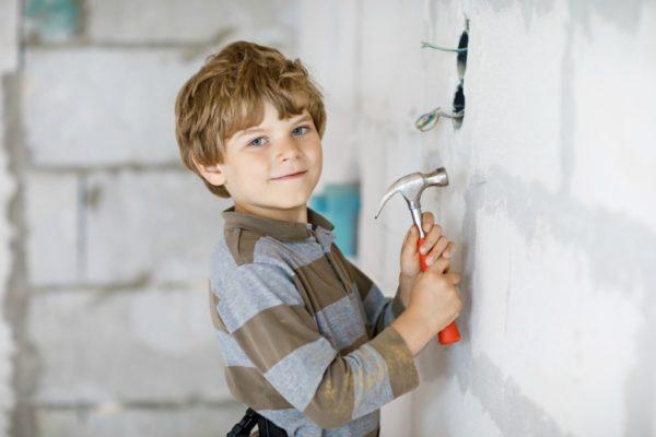 little boy helping builders