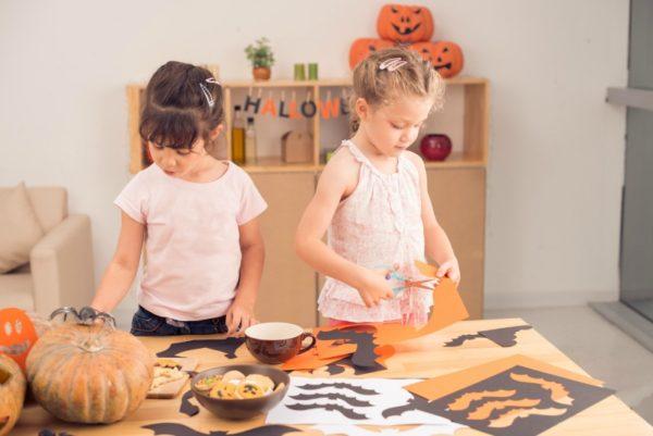 Two little girls doing Halloween craft