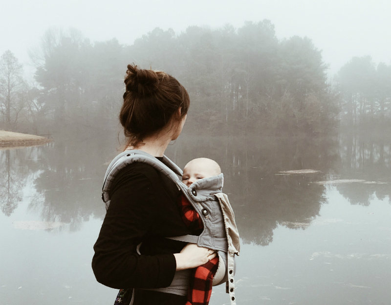 mother and baby with ergobaby carrier