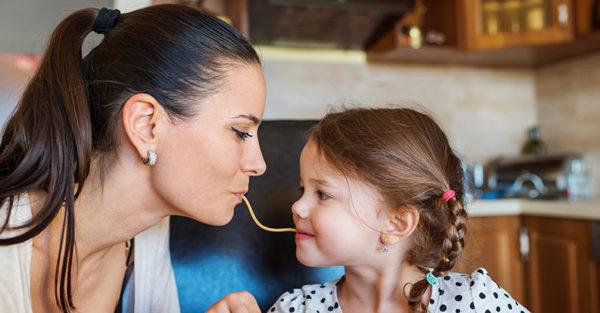 mum and daughter eating