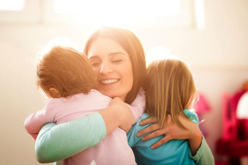 mum holding two kids