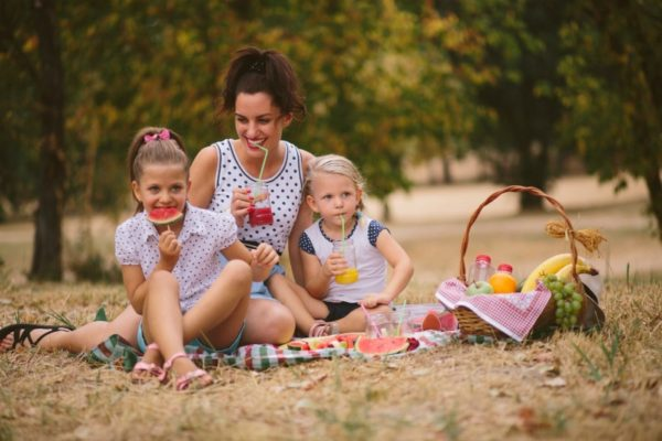 mum and kids having picnic