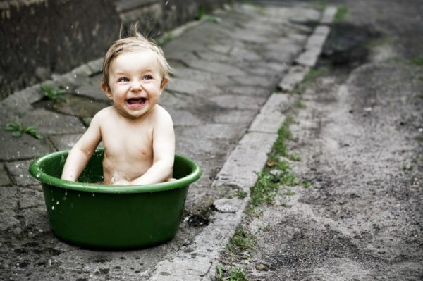 naked toddler in bucket