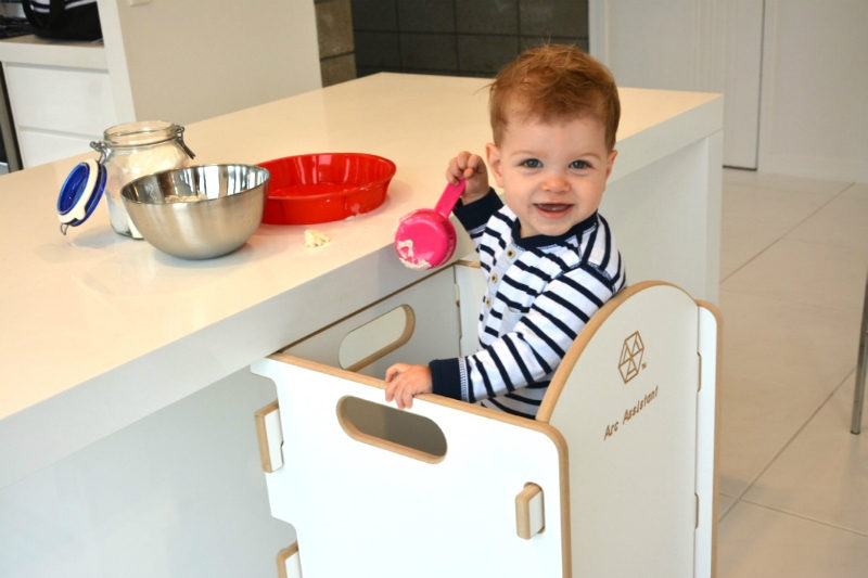 toddler at kitchen bench in arc assistant stool