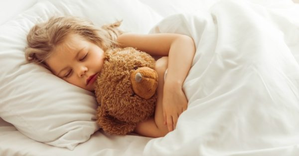 Little girl asleep in bed