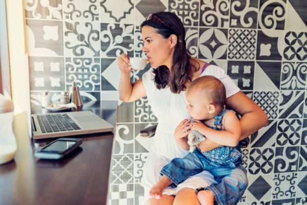 woman with baby and coffee