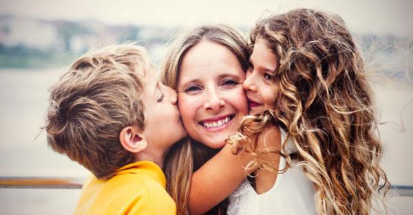 Happy um being kissed by children
