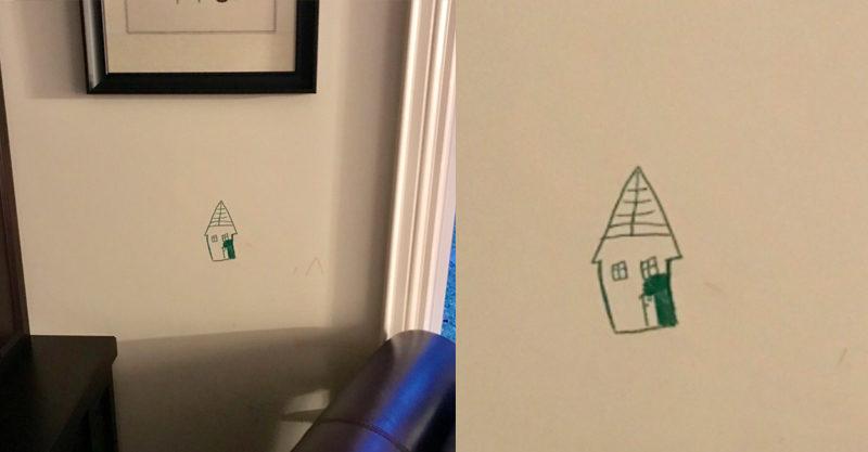 kid draws on wall