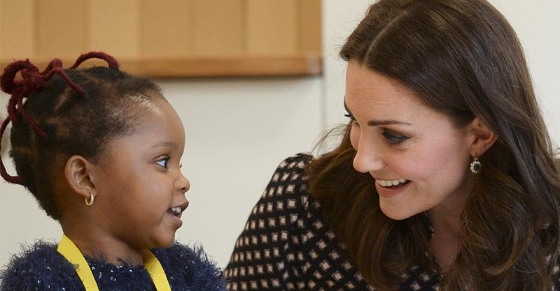 The Duchess of Cambridge chatting to a child