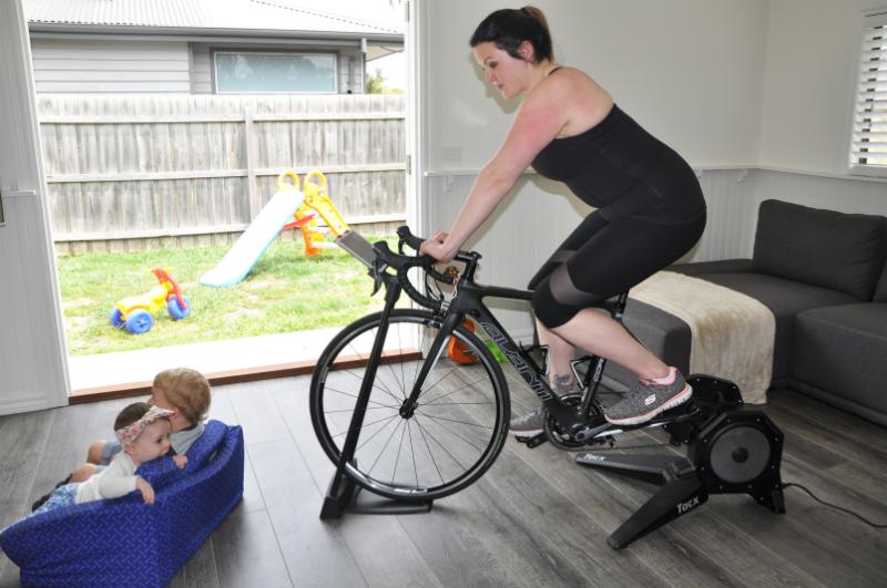 mum using tacx flux indoor trainer