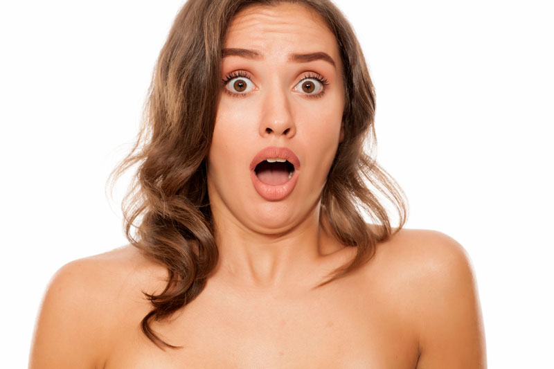 Naked woman in shock