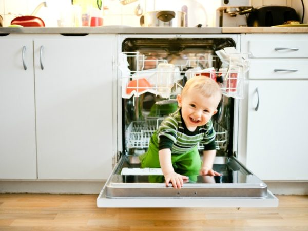 toddler in dishwasher